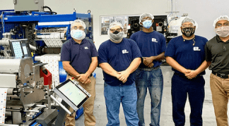 The Essel Propack team in the Danville, Virginia plant alongside the new Gallus Labelmaster 440 press. Photo Heidelberg-Gallus