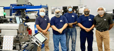The Essel Propack team in the Danville, Virginia plant alongside the new Gallus Labelmaster 440 press. Photo Heidelberg-Gallus