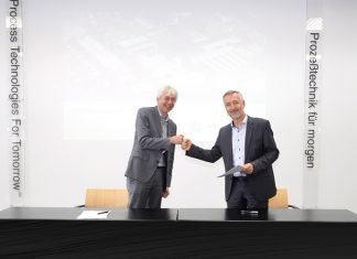 Johannes Wick, CEO Grains & Food at Bühler, and Dr Antonio Fernández, chairman of the executive board at Hosokawa Alpine at the signing of the agreement Photo Bühler